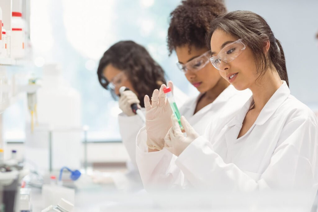Three female scientists working in the lab